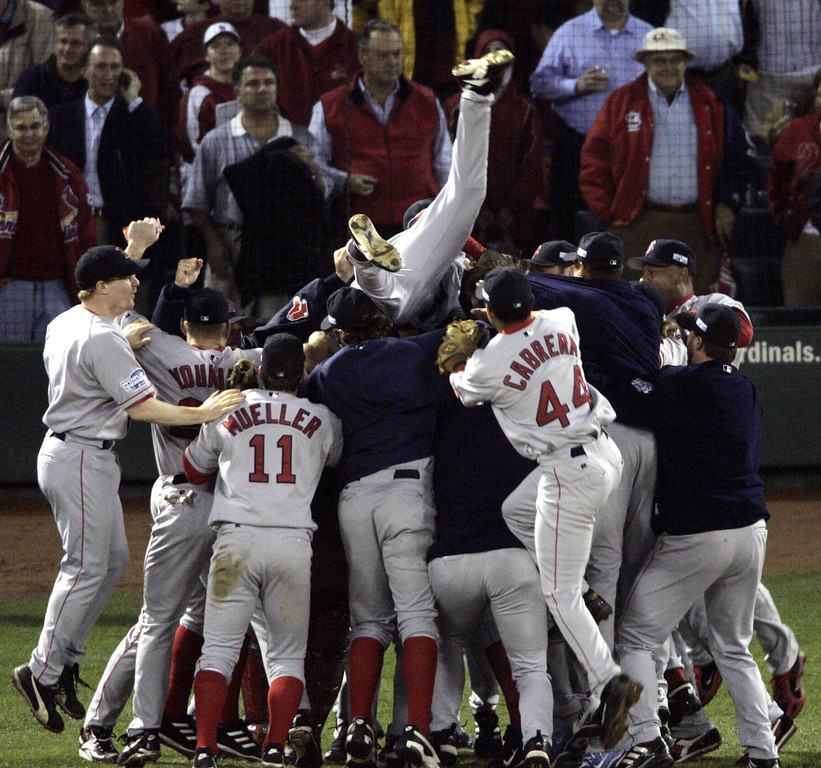 . Boston Red Sox players celebrate after beating the St. Louis Cardinals 3-0 in Game 4 to sweep the World Series Wednesday, Oct. 27, 2004, in St. Louis. (AP Photo/Sue Ogrocki)