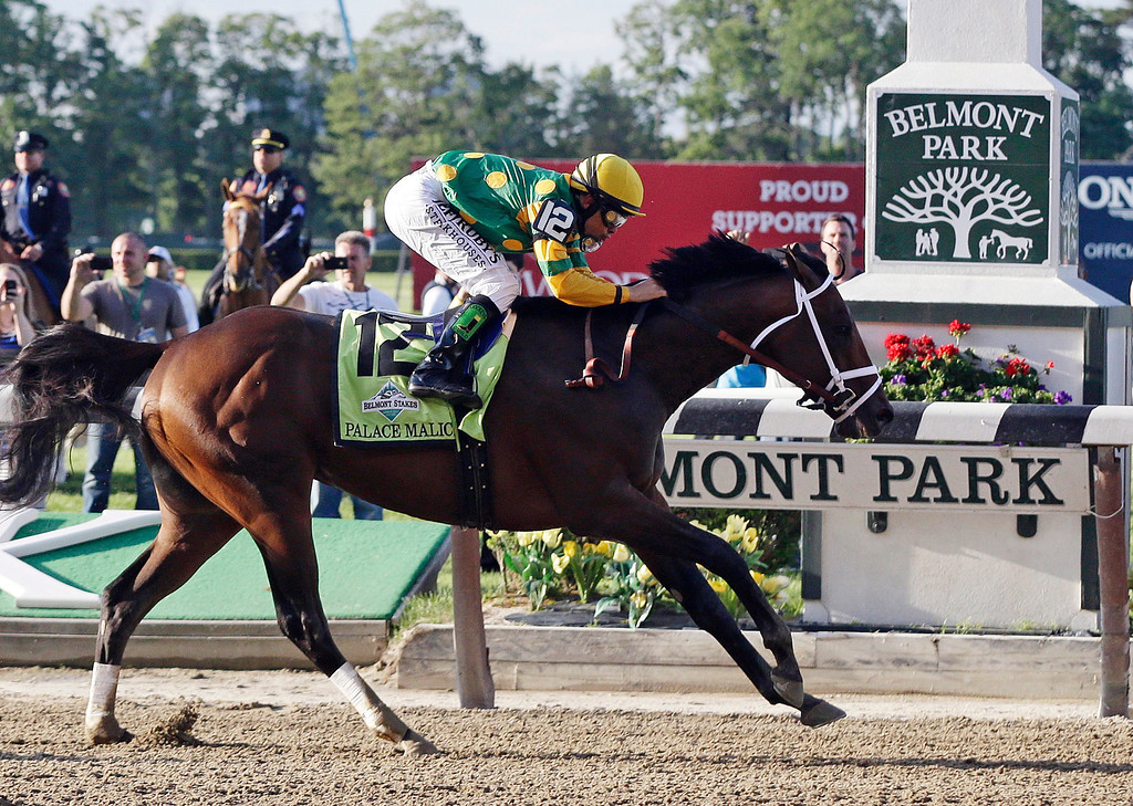 . Palace Malice, ridden by jockey Mike Smith, crosses the finish line to win the the 145th Belmont Stakes horse race at Belmont Park Saturday, June 8, 2013, in Elmont, N.Y. (AP Photo/Frank Franklin II)