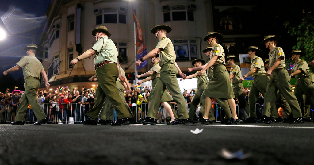 ". Members of the group ""Australian Defence Force - Serving with Pride\"" participate in the 35th annual Sydney Gay and Lesbian Mardi Gras parade March 2, 2013.  REUTERS/Tim Wimborne"