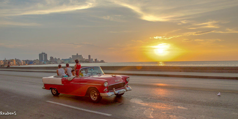 Red car at  sunset Malecon.jpg
