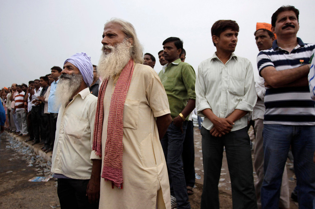 . Two elderly men, front, listen to a speaker at a political rally in New Delhi on Sept. 29, 2013. Much of the world is not prepared to support the ballooning population of elderly people, including many of the fastest-aging countries, according to a global study scheduled to be released Tuesday, Oct. 1, by the United Nations and an elder rights group. (AP Photo/Tsering Topgyal)