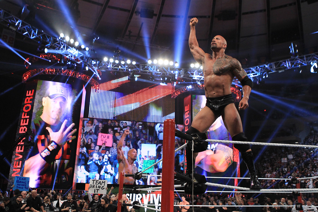 """. In this image released by WWE, actor and wrestler Dwayne \""""The Rock\"""" Johnson competes in the 25th Anniversary of Survivor Series at Madison Square Garden, Sunday, Nov. 20, 2011 in New York. Returning to the wrestling ring after seven years, The Rock teamed with WWE Superstar John Cena in the main event against the Tag team of \""""Awesome Truth,\"""" consisting of wrestlers The Miz and R-Truth. (AP Photo/WWE)"""