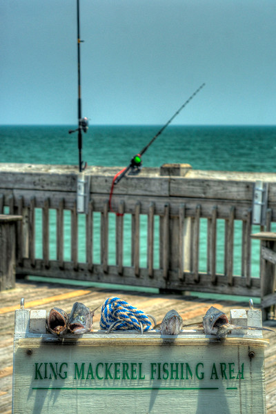 Fisherman cut the heads off mackerel caught on the pier, displaying them on a sign as a trophy of their catch, at the Folly Beach Edwin S. Taylor Pier in Folly Beach, SC on Wednesday, July 4, 2012. Copyright 2012 Jason Barnette