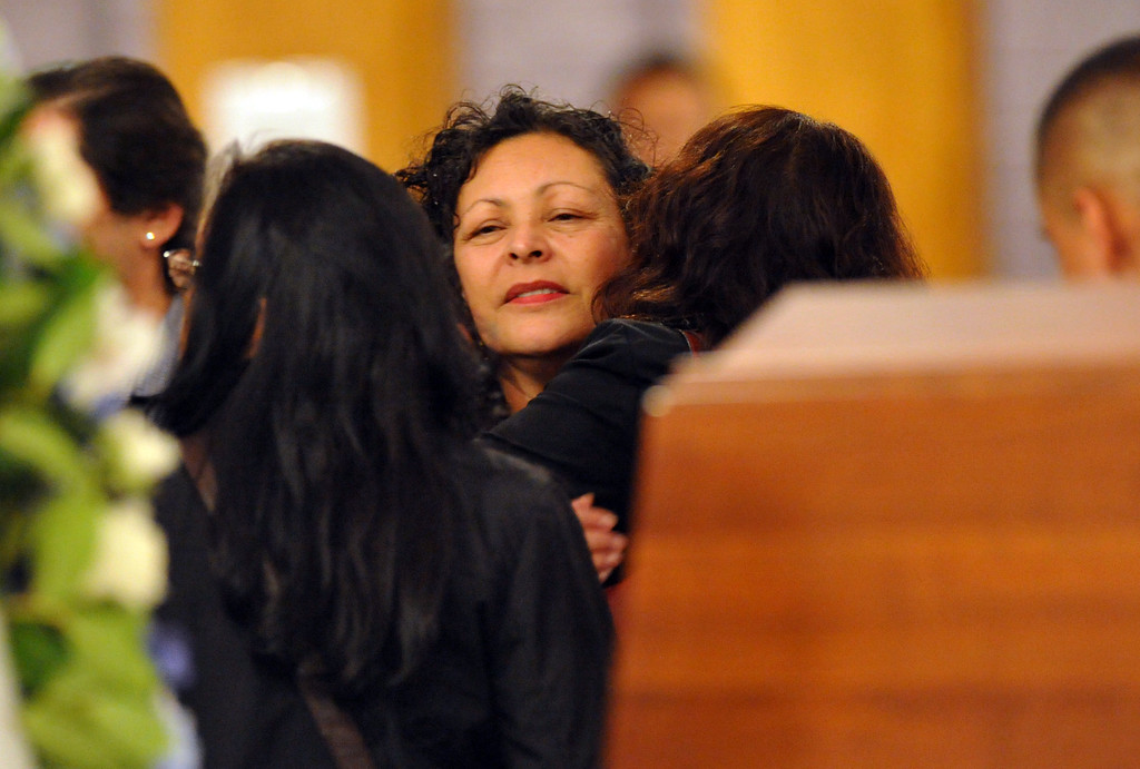 ". Family members of restaurant owner Manuel Rojas are comforted during the Rosary service at Assumption Church in Boyle Heights on February 25, 2013. Rojas, owner of Manuel\'s Original El Tepeyac Cafe, he was known for making the famous ""Hollenbeck\"" burrito. (SGVN/Staff Photo by Keith Durflinger)"