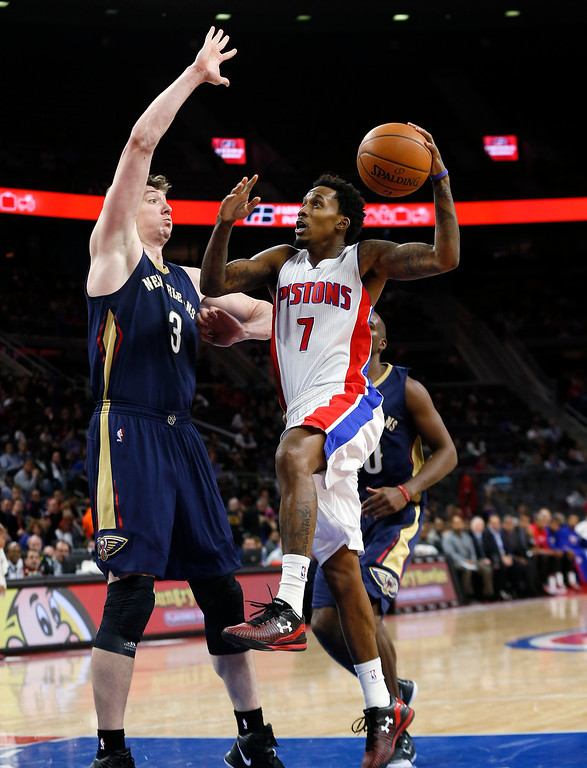 . Detroit Pistons guard Brandon Jennings (7) drives on New Orleans Pelicans center Omer Asik (3) during the first half of an NBA basketball game in Auburn Hills, Mich., Wednesday, Jan. 14, 2015. (AP Photo/Paul Sancya)