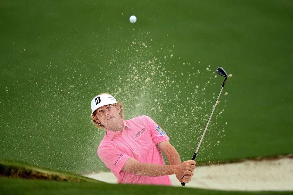 . Brandt Snedeker of the United States hits out of the bunker on the second hole during the final round of the 2013 Masters Tournament at Augusta National Golf Club on April 14, 2013 in Augusta, Georgia.  (Photo by Harry How/Getty Images)
