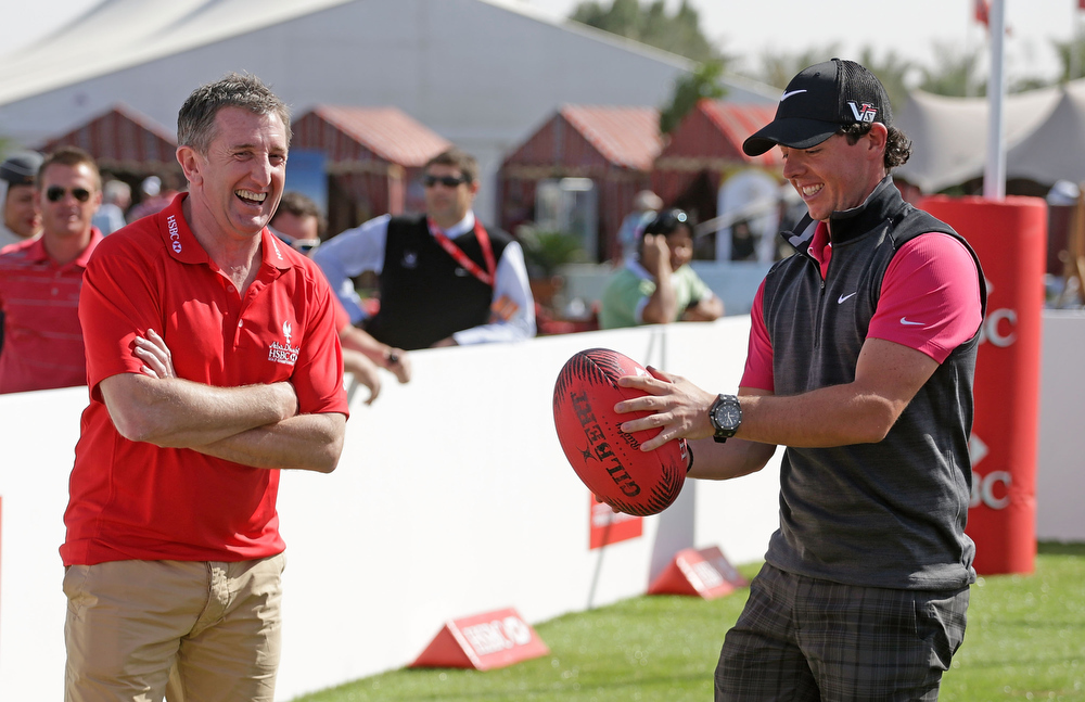 Description of . Rory McIlroy of Northern Ireland chats with Welsh rugby legend Jonathan Davies in the spectator village  during the first round of the Abu Dhabi HSBC Golf Championship at Abu Dhabi Golf Club on January 17, 2013 in Abu Dhabi, United Arab Emirates.  (Photo by Scott Halleran/Getty Images)