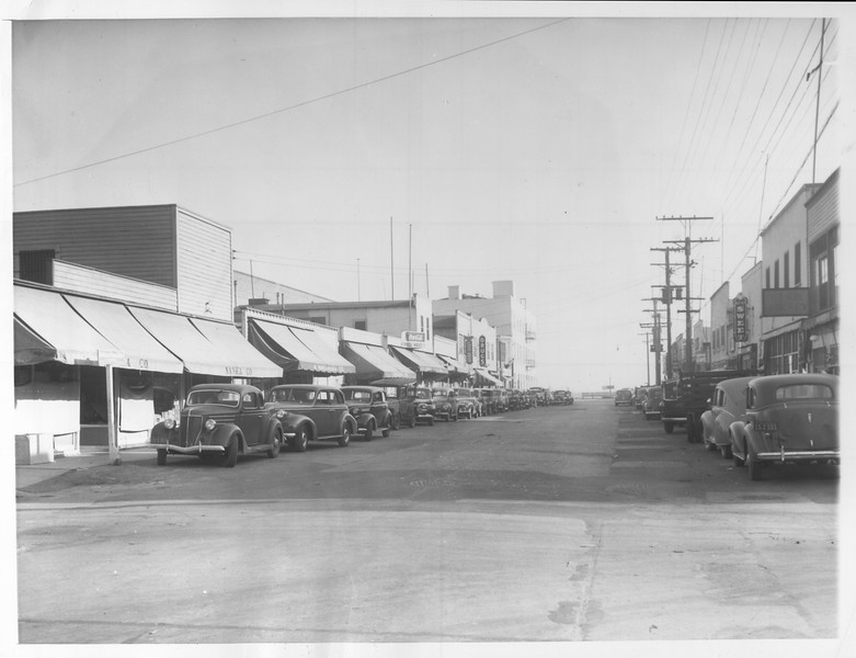 """""""Scene on Tuna Street, principal Japanese business artery on Terminal Island.  Fishing is the big industry and all the Japanese on the island are in some way connected with it.""""--caption on photograph"""