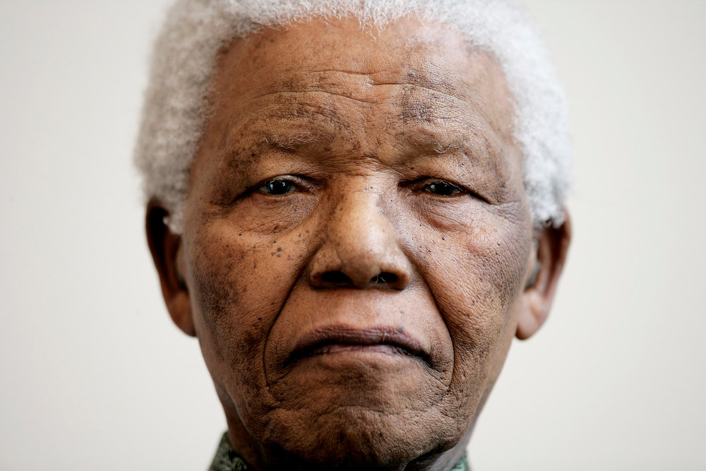 ". Nelson Mandela attends a photocall ahead of tonight\'s ""46664 Arctic\"" concert, at the Rica Hotel on June 11, 2005 in Tromso, Norway. The fourth concert aims to raise awareness of and funds for the global HIV/AIDS pandemic, as well as funds for South Africa with proceeds going to the Nelson Mandela Foundation. Produced by Robbie Williams, it follows 3 previous concerts held in Cape Town, George and Madrid, and Mandela is expected to make a personal plea to leaders of the G8 summit in his address.  (Photo by Getty Images)"