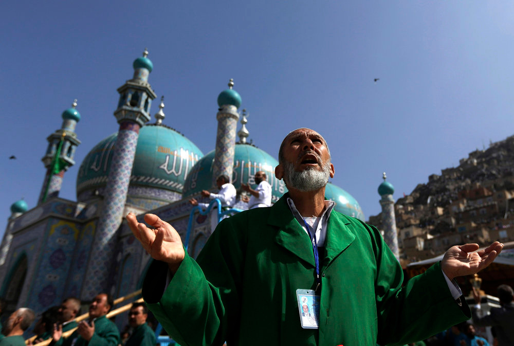 . An Afghan man prays during a celebration for Afghan New Year (Nawroz) in Kabul March 21, 2013. Afghanistan uses the Persian calendar which runs from the vernal equinox. The calendar takes as its start date the time when the Prophet Mohammad moved from Mecca to Medina in 621 AD. The current Persian year is 1392. REUTERS/Omar Sobhani