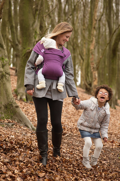 Izmi_Baby_Carrier_Cotton_Purple_Front_Carry_mum_forest_with_daughter_laughing.jpg
