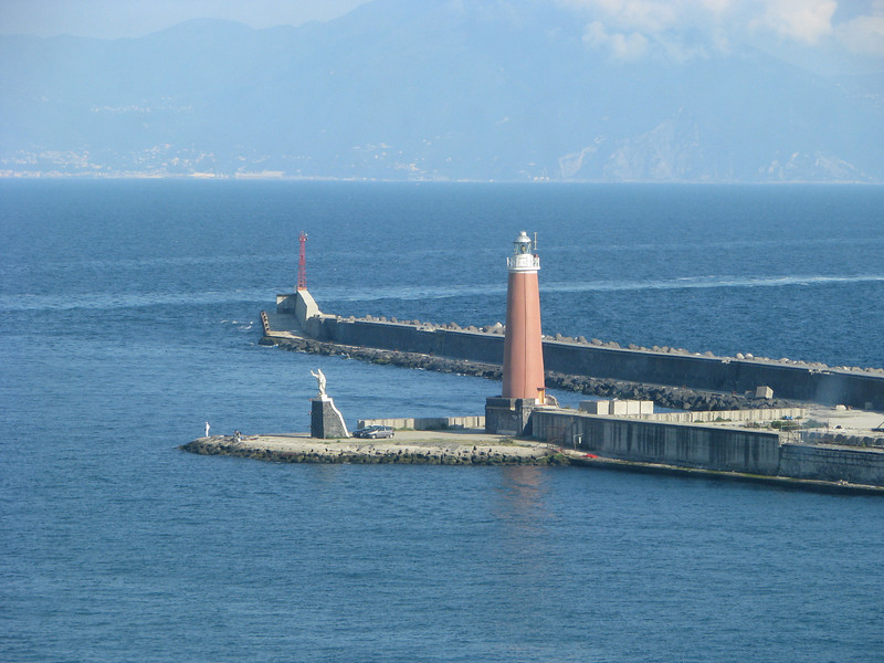 Lighthouse and seawall in Naples, Italy