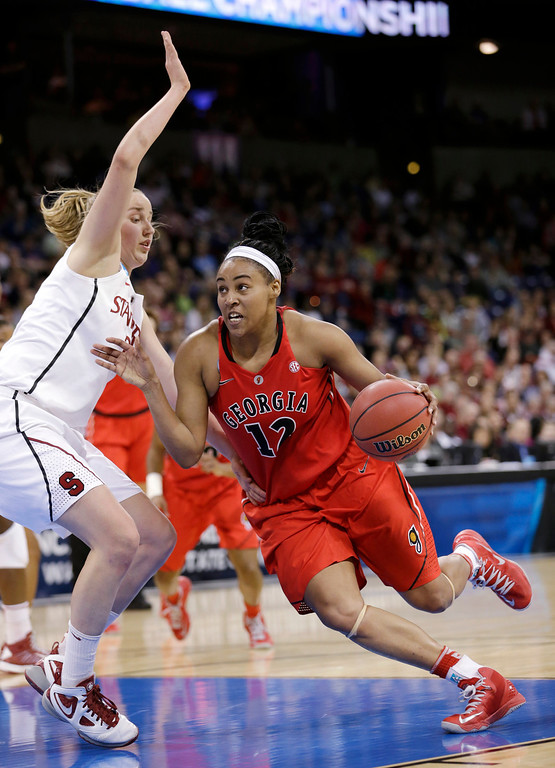 . Georgia\'s Jasmine Hassell (12) drives against Stanford\'s Mikaela Ruef in the second half of a regional semifinal in the NCAA women\'s college basketball tournament Saturday, March 30, 2013, in Spokane, Wash. Georgia won 61-59. (AP Photo/Elaine Thompson)