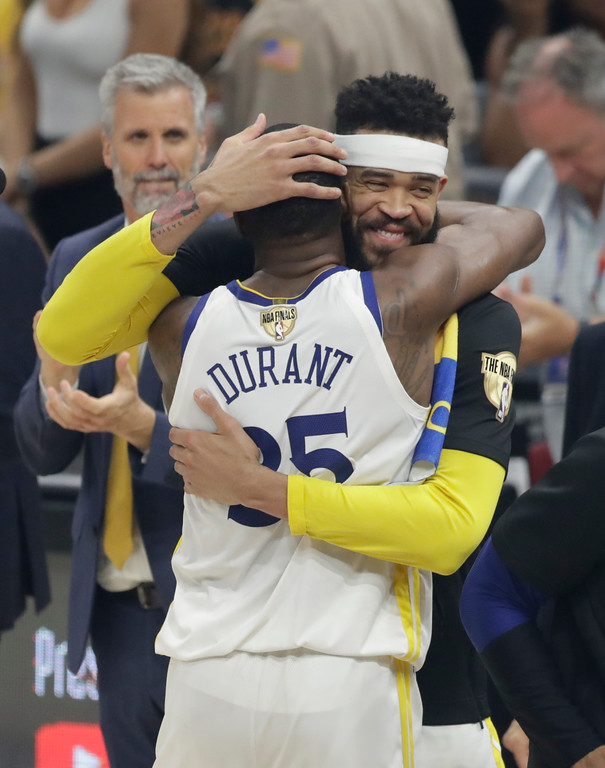 . Golden State Warriors\' Kevin Durant (35) and JaVale McGee celebrate following Game 4 of basketball\'s NBA Finals, Friday, June 8, 2018, in Cleveland. The Warriors defeated the Cavaliers 108-85. (AP Photo/Tony Dejak)