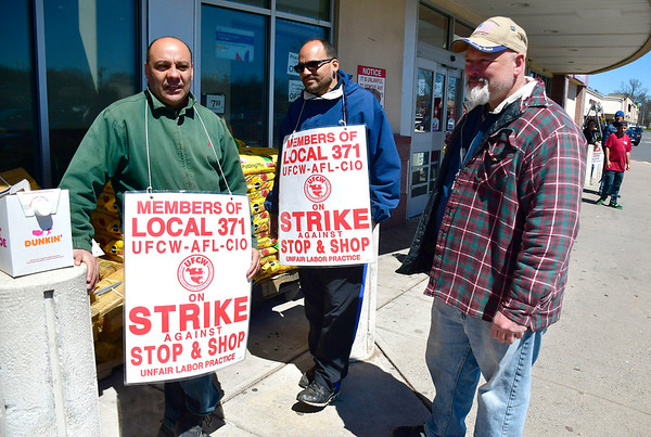 4/16/2019 Mike Orazzi | Staff Stop & Shop workers, left to right: Carlos Neves, Jose Caceres and Ted Bouchard while on strike at the Farmington Avenue location in Bristol Tuesday.