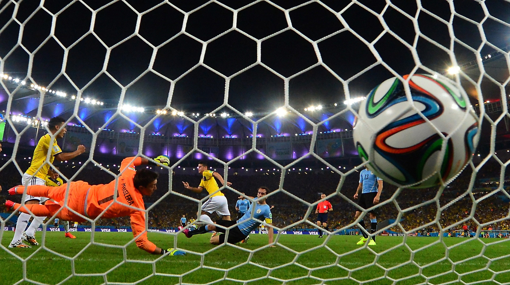 . Uruguay\'s goalkeeper Fernando Muslera fails to save Colombia\'s midfielder James Rodriguez\' second goal during the Round of 16 football match between Colombia and Uruguay at the Maracana Stadium in Rio de Janeiro during the 2014 FIFA World Cup in Brazil on June 28, 2014.  (LUIS ACOSTA/AFP/Getty Images)