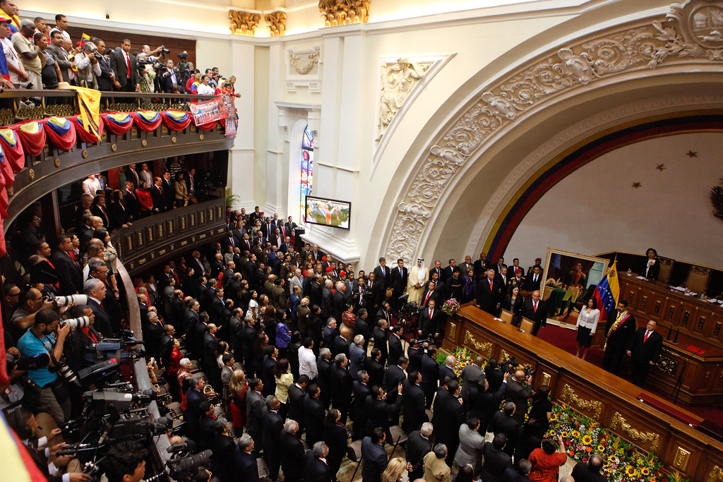 . In this photo released by Miraflores Press Office, a general view of the swearing-in ceremony of President-elect Nicolas Maduro at the National Assembly in Caracas, Venezuela, Friday, April 19, 2013. The opposition boycotted the ceremony, hoping that the ruling party\'s last-minute decision to allow an audit of nearly half the vote could change the result in a the bitterly disputed presidential election. (AP Photo/Miraflores Press Office)