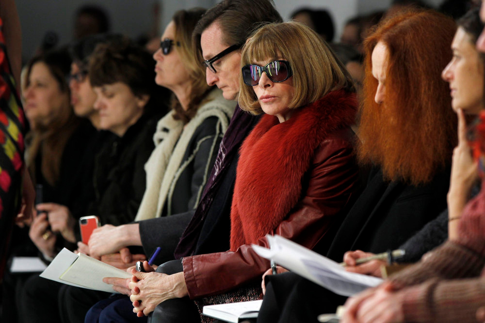 Description of . Vogue editor Anna Wintour watches a presentation of the Rodarte Autumn/Winter 2013 collection during New York Fashion Week, February 12, 2013. REUTERS/Lucas Jackson
