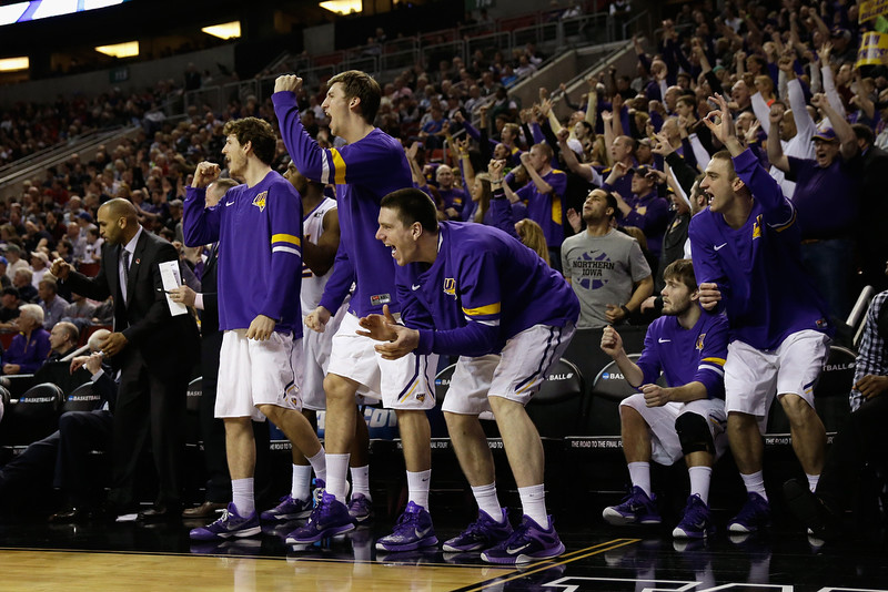 . Members of the Northern Iowa Panthers reacts after a teammate scored a three pointer against the Wyoming Cowboys during the second round of the 2015 Men\'s NCAA Basketball Tournament at KeyArena on March 20, 2015 in Seattle, Washington.  (Photo by Ezra Shaw/Getty Images)