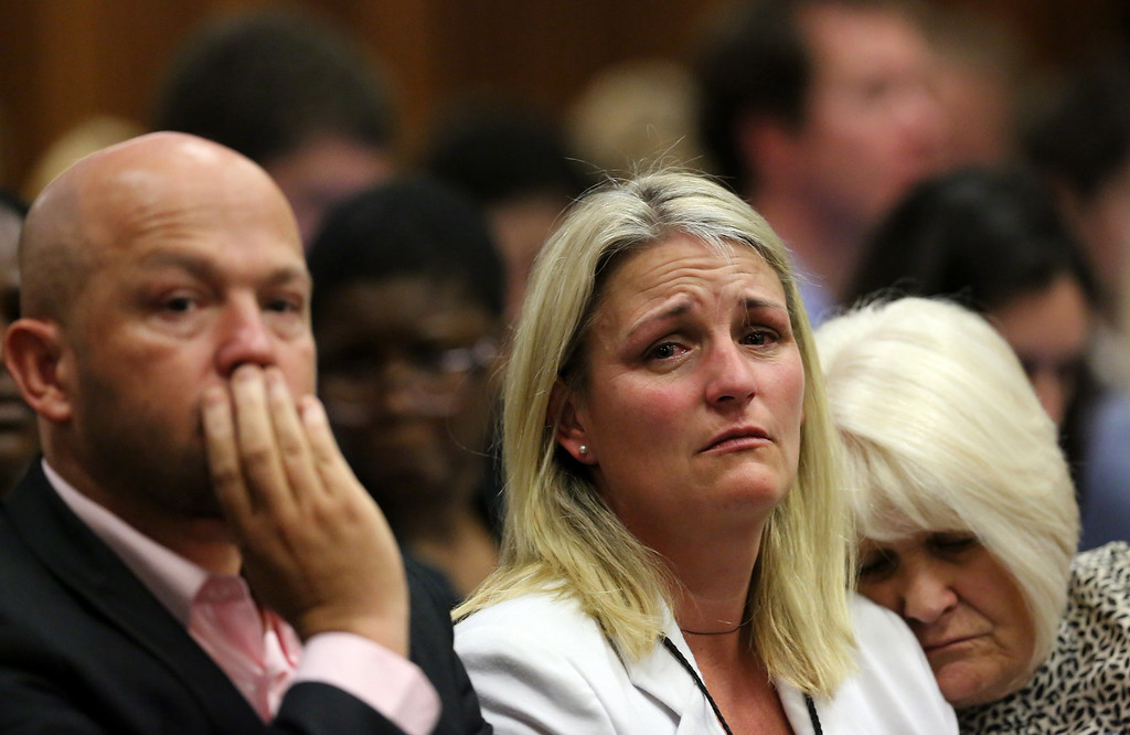 . Family members of Reeva Steenkamp react as they listen to the verdict of Olympic and Paralympic track star Oscar Pistorius at the high court in Pretoria  on September 12, 2014. Pistorius was convicted of culpable homicide on Friday, having escaped the more serious charge of murder for the killing of his girlfriend, and the Olympic and Paralympic track star could face a lengthy prison sentence. Siphiwe Sibeko/AFP/Getty Images