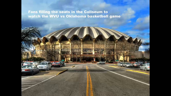 Fans filling Coliseum at basketball game