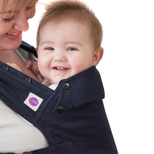 Izmi_Baby_Carrier_Cotton_Midnight_Blue_Product_Shot_Back_Carry_Side_Angle_With_Mum_And_Baby.jpg
