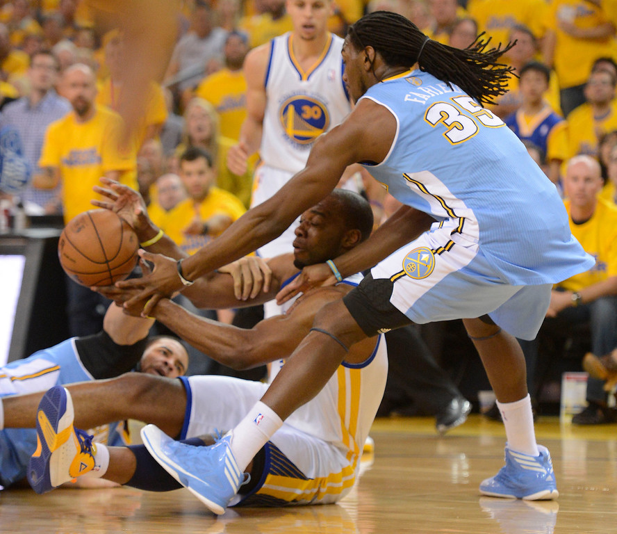 . Carl Landry (7) of the Golden State Warriors scrambles for a lose ball with Kenneth Faried (35) of the Denver Nuggets and JaVale McGee (34) during the first quarter in Game 6 of the first round NBA Playoffs May 2, 2013 at Oracle Arena. (Photo By John Leyba/The Denver Post)