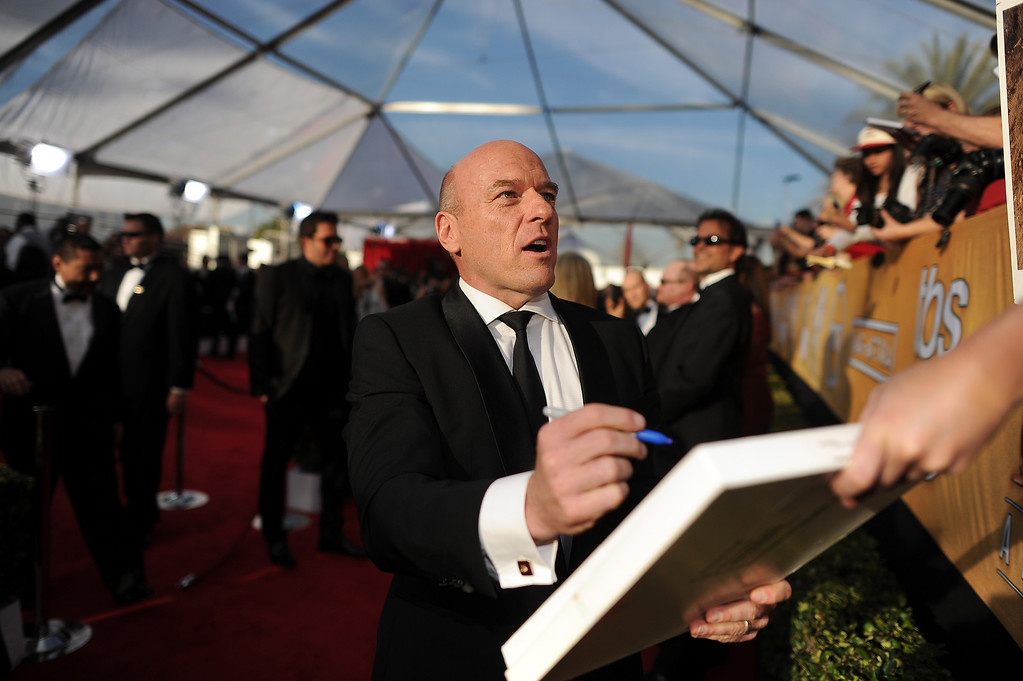 . Dean Norris signs autographs on the red carpet at the 20th Annual Screen Actors Guild Awards  at the Shrine Auditorium in Los Angeles, California on Saturday January 18, 2014 (Photo by Hans Gutknecht / Los Angeles Daily News)