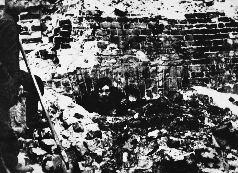 . A man emerges from an underground bunker during the liquidation of the Warsaw ghetto during World War II, 1943. (AP Photo)