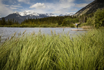 Yoga amidst the greenery of Vermilion Lakes, Banff National Park, Alberta, Canada.