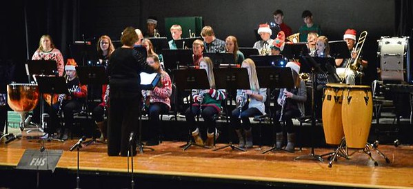 """. The combined Junior-Senior High Bands play \""""Little Drummer Boy\"""" during Tuesday\'s Fleming School Christmas program. The band also performed \""""Santa\'s Rockin\' Holiday Mix,\"""" \""""Do You Hear What I Hear,\"""" \""""The Christmas Song,\"""" \""""Cambridge Carol,\"""" and \""""African Noel\"""" with trumpet trio Dillon Nolde, Lauren Whittington and instructor Jeri Anderson"""