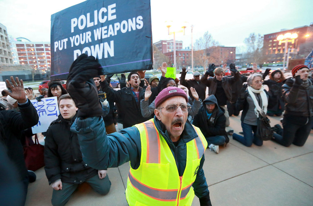 . Tarak Kauff of New York, a member with Veterans for Peace, joins local protesters in front of the Thomas F. Eagleton U.S. Courthouse in downtown St. Louis on Wednesday, Dec. 3, 2014, hours after a white New York police officer was not indicted in the choking death of Eric Garner. (AP Photo/St. Louis Post-Dispatch, Christian Gooden) EDWARDSVILLE INTELLIGENCER OUT; THE ALTON TELEGRAPH OUT