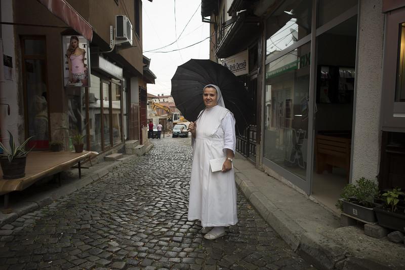 Nun in white and umbrella.jpg