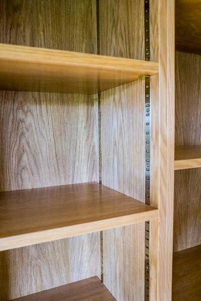 Oak veneered bookcase with full adjustable shelves.