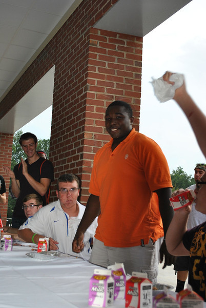 The winner of the first round of the pie eating contest.