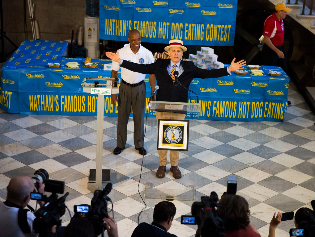. George Shea, center, begins the weight in for the Nathan\'s Hotdog Eating Contest Monday, July 3, 2017, in Brooklyn, New York. (AP Photo/Michael Noble)