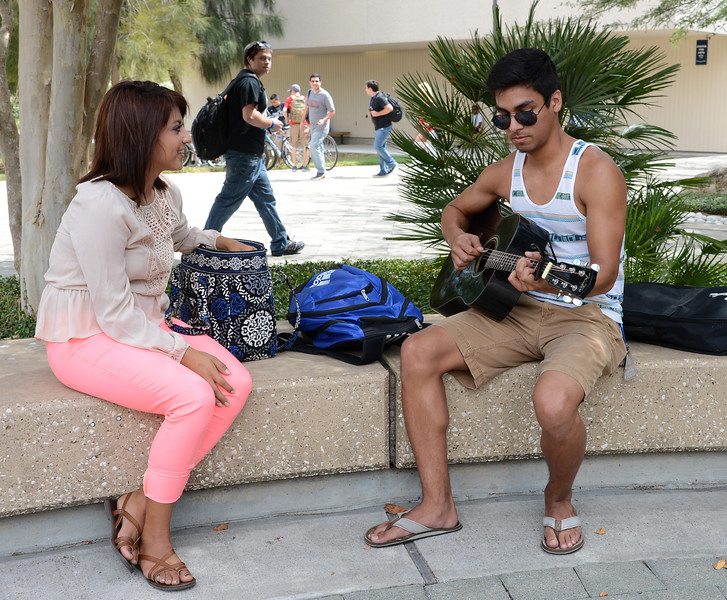 a-student-practices-playing-the-guitar-between-classes_15201484842_o.jpg