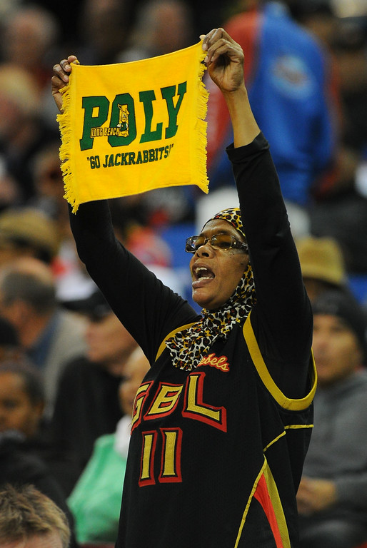 . A Poly fan cheers from the stands at Sleep Train Arena in Sacramento, CA on Saturday, March 29, 2014. Long Beach Poly vs Salesian in the CIF Open Div girls basketball state final. 2nd half. Poly won 70-52. (Photo by Scott Varley, Daily Breeze)