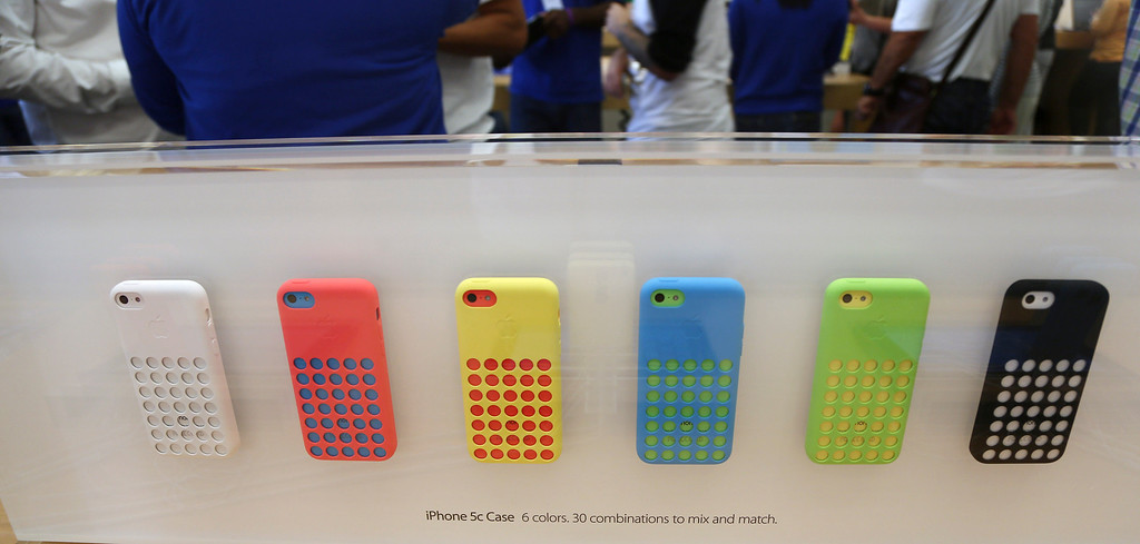 . A row of iPhone 5c phones are on display at the Apple Store on Lincoln Road in Miami Beach, Fla., Friday, Sept. 20, 2013, the first day of sales for the phone. (AP Photo/J Pat Carter)
