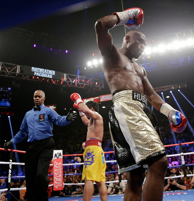 . Floyd Mayweather Jr., right, reacts after the welterweight title fight against  Manny Pacquiao, from the Philippines, on Saturday, May 2, 2015 in Las Vegas. (AP Photo/Isaac Brekken)