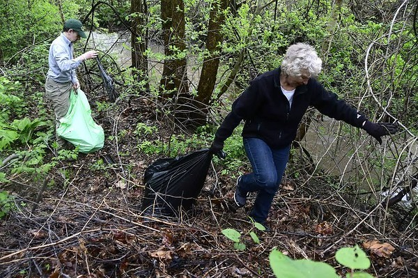 5/6/2017 Mike Orazzi | StaffRandy Paz and Leslie Sundell collect trash along the Quinnipiac River during Saturday's clean up.