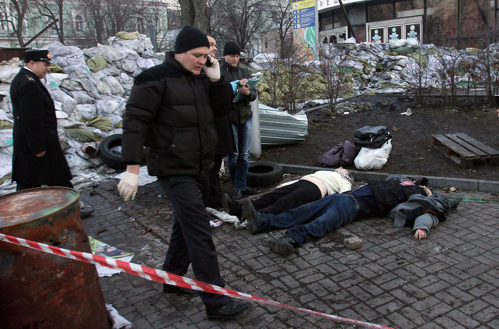 . Police experts examine bodies of the dead anti-government protesters after their clashes with the police in Kiev on February 18, 2014. AFP PHOTO/ ANATOLII  BOIKO/AFP/Getty Images