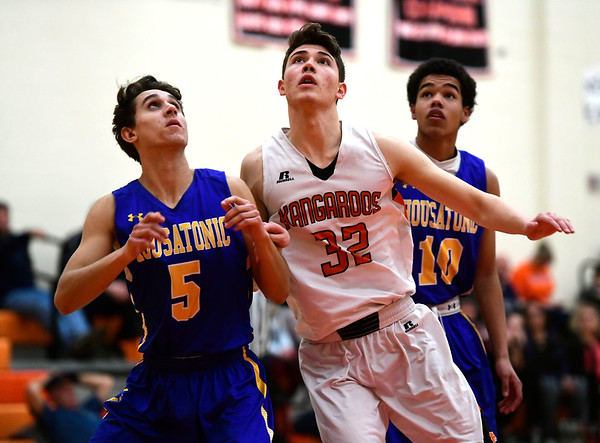 2/15/2019 Mike Orazzi | Staff Terryville High School's Kyle Miranda (32) and Housatonic Regional's Zachary Ongley (5) during Friday night's boys basketball game in Plymouth.