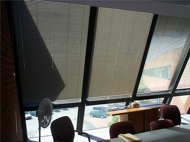 "1"" Aluminum Mini Blind on Inclined window in conference room"