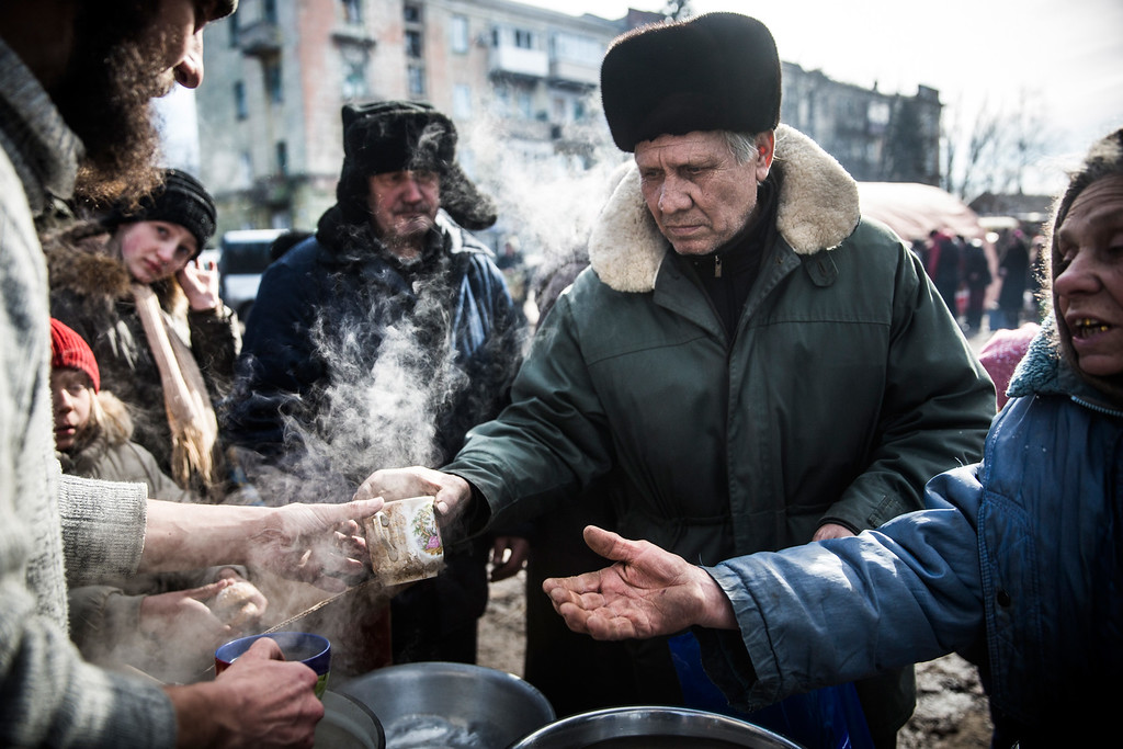 . DEBALTSEVE, UKRAINE - FEBRUARY 25:  Russian backed rebels serve hot tea to civilians on February 25, 2015 in Debaltseve, Ukraine. After approximately one month of fighting, Russian backed rebels successfully forced Ukrainian troops to withdraw from the town of 100,00 people on February 18. Only approximately 11,000 civilians remain in the town. Debaltseve is considered an asset to both Ukrainians and the rebels due to the railway station and it\'s connection to other eastern Ukranian towns.  (Photo by Andrew Burton/Getty Images)