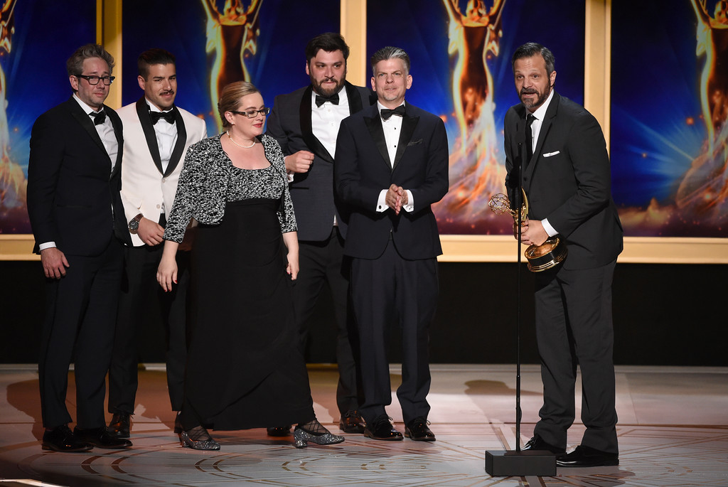 ". The team from ""United Shades of America With W. Kamau Bell\"" accepts the award for outstanding unstructured reality program during night two of the Television Academy\'s 2018 Creative Arts Emmy Awards at the Microsoft Theater on Sunday, Sept. 9, 2018, in Los Angeles. (Photo by Phil McCarten/Invision/AP)"