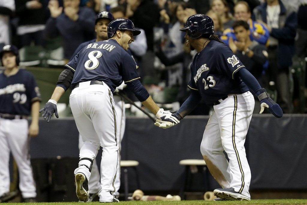 . MILWAUKEE, WI - APRIL 2: Ryan Braun #8 of the Milwaukee Brewers celebrates with Rickie Weeks #23 after hitting a two-run homer in the bottom of the third inning against the Colorado Rockies at Miller Park on April 2, 2013 in Milwaukee, Wisconsin. (Photo by Mike McGinnis/Getty Images)
