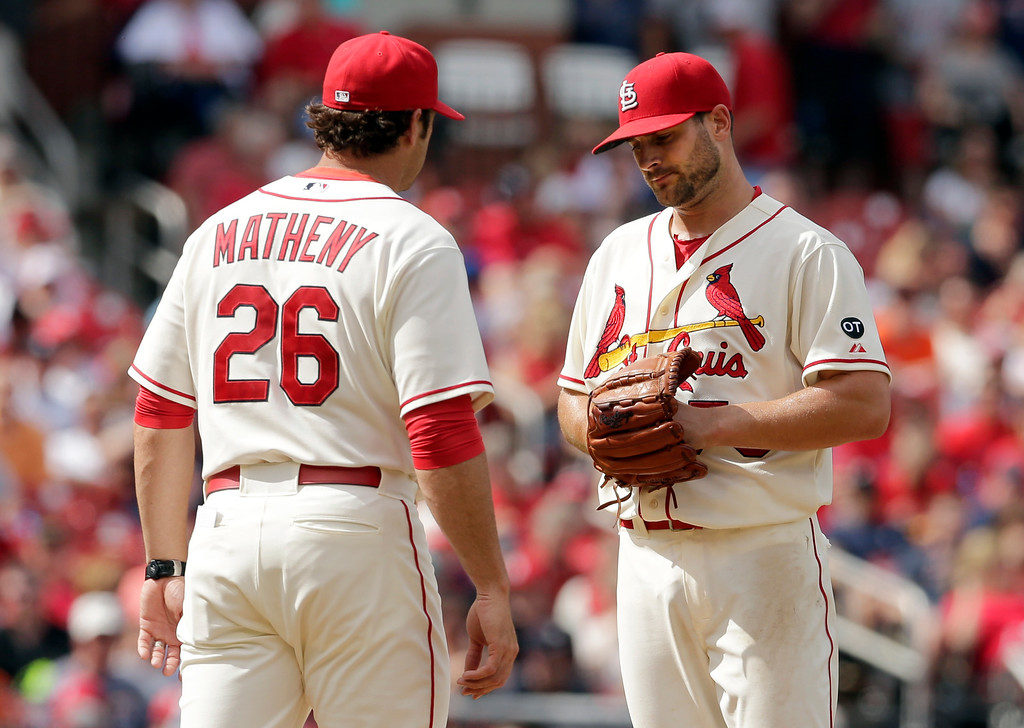 . St. Louis Cardinals manager Mike Matheny, left, removes starting pitcher Tyler Lyons from a baseball game against the Detroit Tigers during the fourth inning, Saturday, May 16, 2015, in St. Louis. (AP Photo/Jeff Roberson)