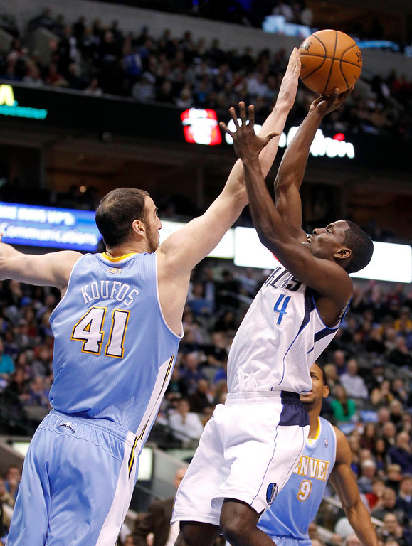 . Denver Nuggets center Kosta Koufos (L) blocks the shot of Dallas Mavericks guard Darren Collison during the first half of their NBA basketball game in Dallas, Texas December 28, 2012.  REUTERS/Mike Stone (UNITED STATES - Tags: SPORT BASKETBALL)