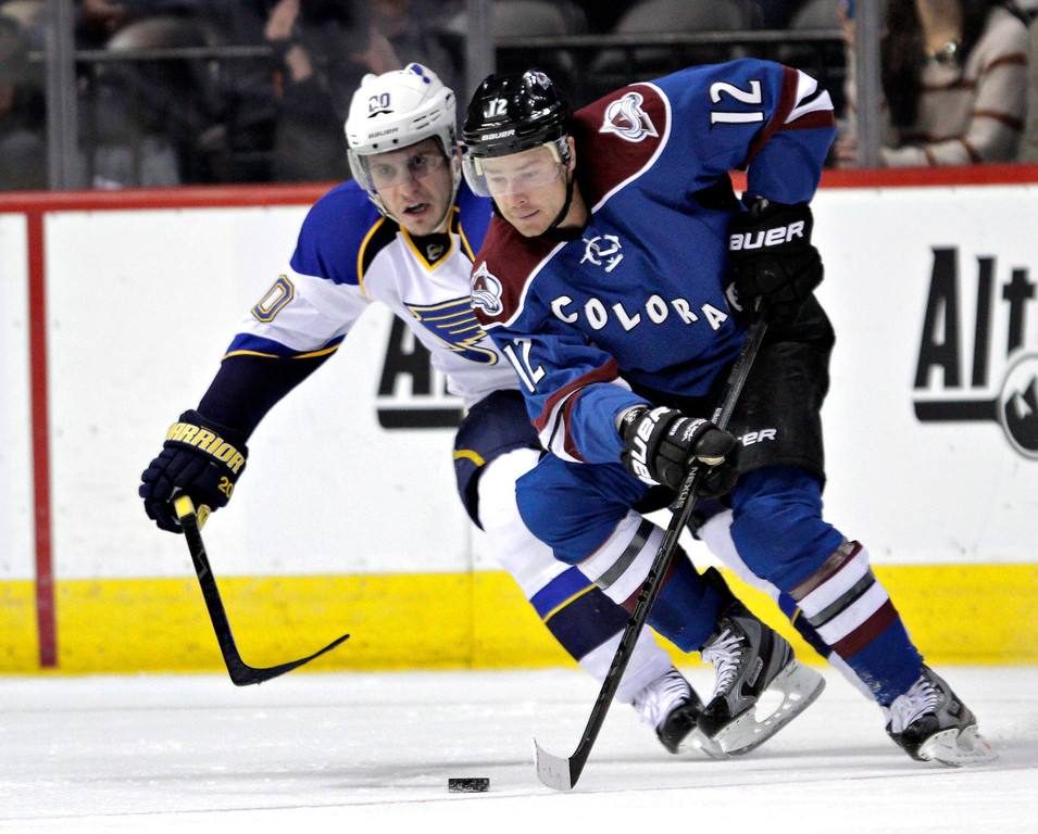 . Colorado Avalanche right wing Chuck Kobasew (12) keeps the puck away from St. Louis Blues left wing Alexander Steen (20) during the second period of an NHL hockey game, Wednesday, Feb. 20, 2013, in Denver. (AP Photo/Joe Mahoney)